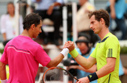 MADRID, SPAIN - MAY 08:  Andy Murray of Great Britain shakes hands at the net after his straight sets defeat by Santiago Giraldo of Columbia in their third round match during day six of the Mutua Madrid Open tennis tournament at the Caja Magica on May 8, 2014 in Madrid, Spain.  (Photo by Clive Brunskill/Getty Images)