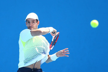 MELBOURNE, AUSTRALIA - JANUARY 22:  Santiago Giraldo of Colombia plays a forehand in his second round match against Steve Johnson of the United States during day four of the 2015 Australian Open at Melbourne Park on January 22, 2015 in Melbourne, Australia.  (Photo by Cameron Spencer/Getty Images)