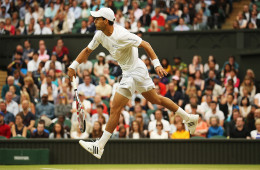 LONDON, ENGLAND - JUNE 28:  Santiago Giraldo of Colombia serves during his Gentlemen's Singles third round match against Roger Federer of Switzerland on day six of the Wimbledon Lawn Tennis Championships at the All England Lawn Tennis and Croquet Club at Wimbledon on June 28, 2014 in London, England.  (Photo by Matthew Stockman/Getty Images)