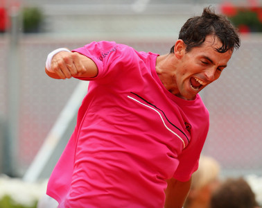 MADRID, SPAIN - MAY 08:  Santiago Giraldo of Columbia celebrates after his straight sets victory against Andy Murray of Great Britain in their third round match during day six of the Mutua Madrid Open tennis tournament at the Caja Magica on May 8, 2014 in Madrid, Spain.  (Photo by Clive Brunskill/Getty Images)