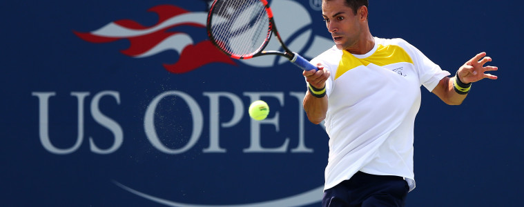 NEW YORK, NY - SEPTEMBER 01:  Santiago Giraldo of Colombia returns a shot against Austin Krajicek of the United States during during their Men's Singles First Round match on Day Two of the 2015 US Open at the USTA Billie Jean King National Tennis Center on September 1, 2015 in the Flushing neighborhood of the Queens borough of New York City.  (Photo by Elsa/Getty Images)
